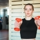Fitness Girl Lifting Dumbbell in the Gym - VideoHive Item for Sale