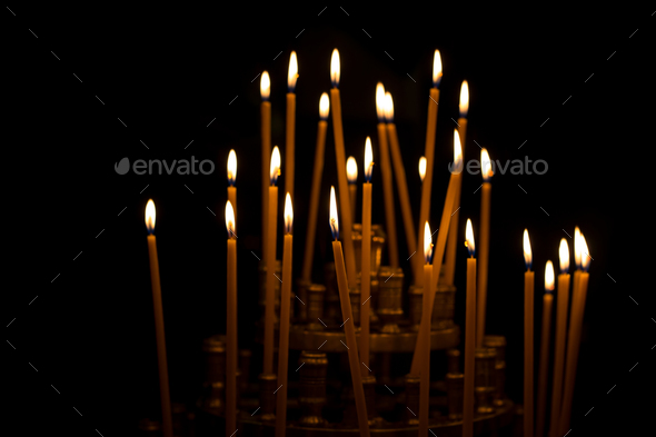 burning candles in a church, easter or memorial - Stock Photo - Images