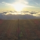 Woman Is Running Above Clouds Towards the Sun and Edge of Mountain and Rising Hands. Aerial View - VideoHive Item for Sale