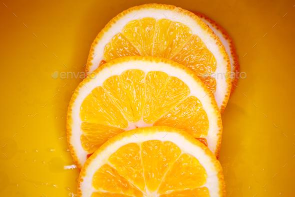 Sliced orange background - Stock Photo - Images