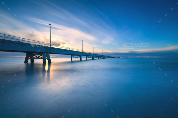 Industrial pier on the sea. Side view. Long exposure photography - Stock Photo - Images