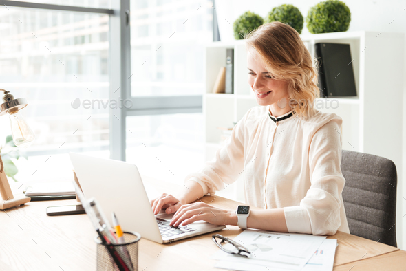 Portrait of a smiling young businesswoman - Stock Photo - Images