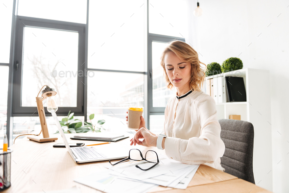 Portrait of a pretty young businesswoman - Stock Photo - Images