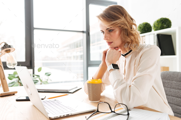 Concentrated serious young business woman - Stock Photo - Images