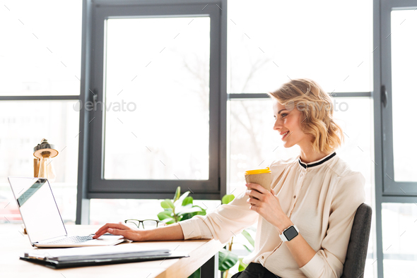 Portrait of an attractive young businesswoman - Stock Photo - Images