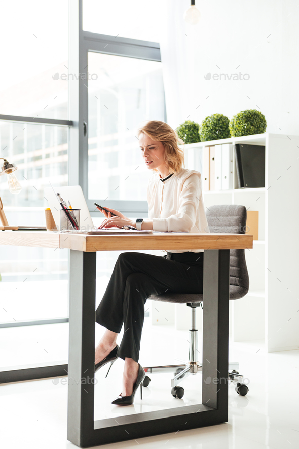 Portrait of a concentrated young businesswoman - Stock Photo - Images