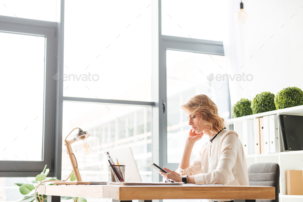 Portrait of a busy young businesswoman - Stock Photo - Images