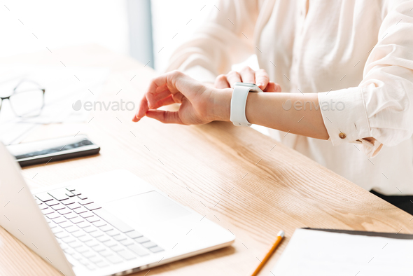 Close up of a woman checking time - Stock Photo - Images