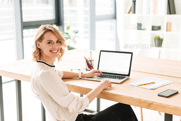 Smiling young business woman - Stock Photo - Images