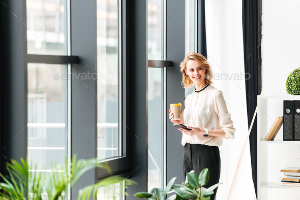 Young business woman in office looking aside chatting - Stock Photo - Images