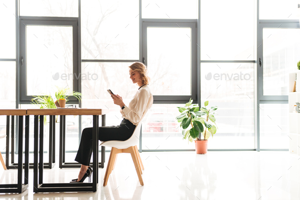 Portrait of a happy young businesswoman - Stock Photo - Images