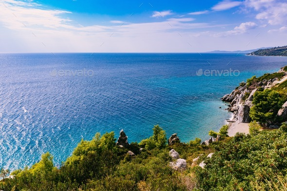 beautiful landscape of turquoise sea and rocky coast in Greece - Stock Photo - Images