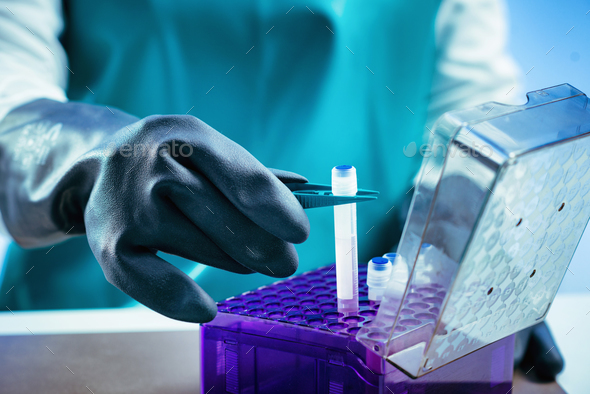 Biobanking. Technician preparing biological sample for deep free - Stock Photo - Images