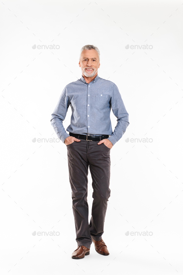 Positive old man looking camera and smiling over white - Stock Photo - Images