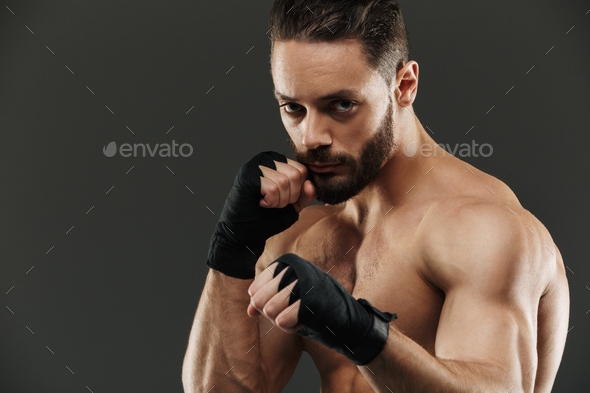 Portrait of a confident muscular boxer ready to fight - Stock Photo - Images