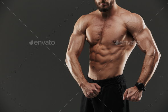 Cropped image of a young muscular bodybuilder - Stock Photo - Images