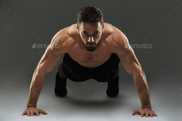 Portrait of a concentrated muscular sportsman - Stock Photo - Images