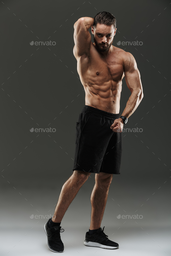 Full length portrait of a confident muscular bodybuilder - Stock Photo - Images