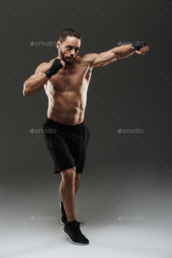 Full length portrait of a motivated muscular sportsman - Stock Photo - Images