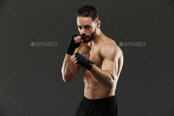 Portrait of a concentrated muscular boxer ready to fight - Stock Photo - Images
