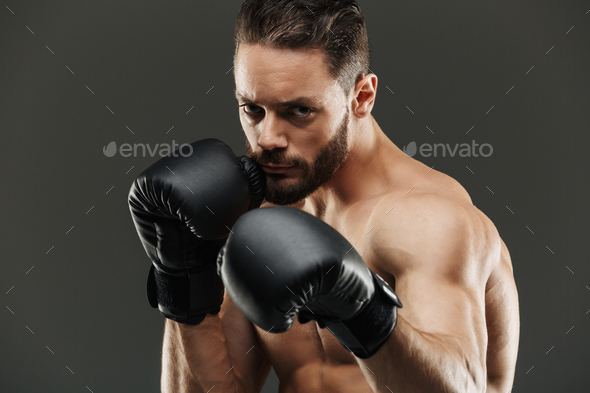 Portrait of a confident muscular sportsman - Stock Photo - Images