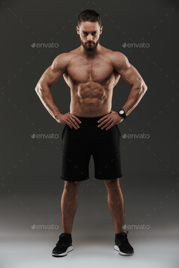 Full length portrait of a confident muscular man posing - Stock Photo - Images