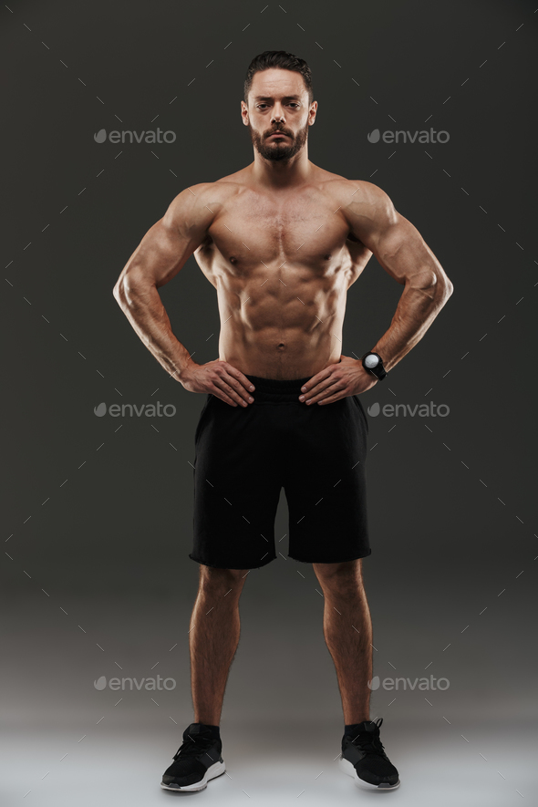 Full length portrait of a motivated muscular man posing - Stock Photo - Images