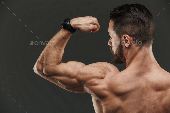 Close up of a muscular bodybuilder flexing biceps - Stock Photo - Images
