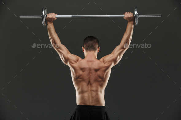 Back view of a fit muscular bodybuilder - Stock Photo - Images