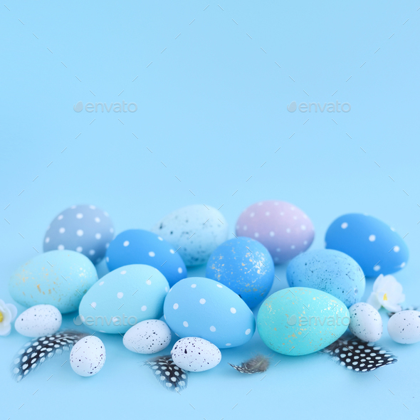 Easter eggs on blue background with empty space. Easter card - Stock Photo - Images