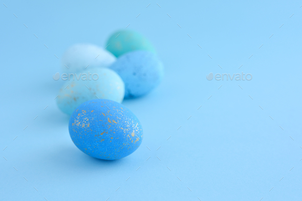 Easter eggs on blue background with empty space - Stock Photo - Images