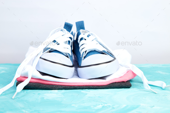 Female sneakers shoes and tee - Stock Photo - Images