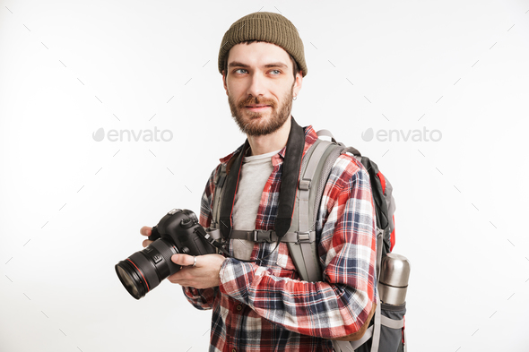 Portrait of a smiling young man tourist - Stock Photo - Images