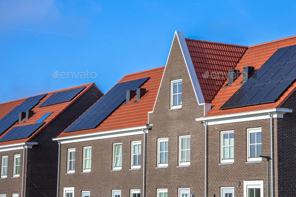 Close up of Modern row houses with  solar panels - Stock Photo - Images