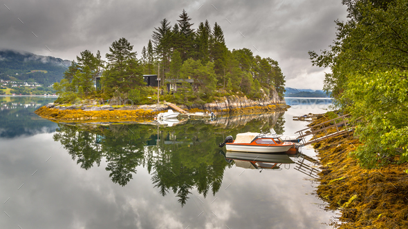 Cottages on an island in Norwegian fjord - Stock Photo - Images