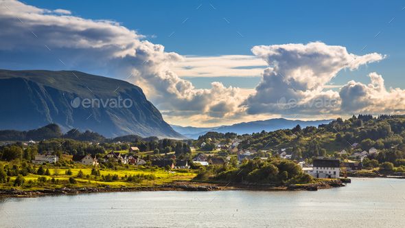 Norwegian village in fjord landscape - Stock Photo - Images