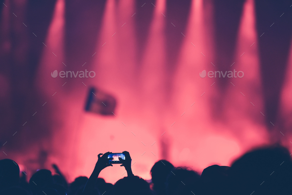 Fan taking photo of concert at festival with a smart phone - Stock Photo - Images