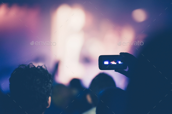 Fan taking photo of concert at festival with a mobile phone - Stock Photo - Images