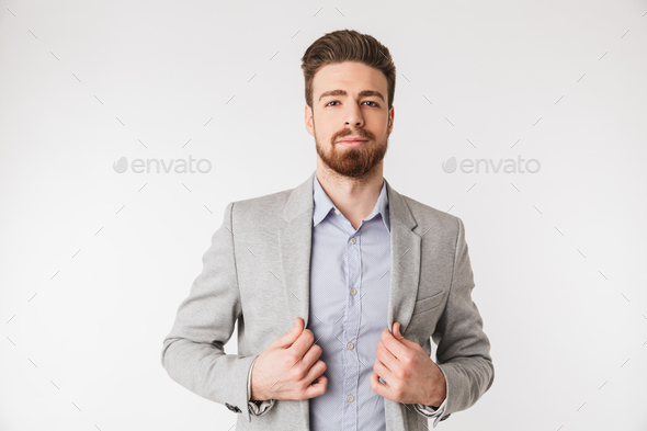 Portrait of a confident young man dressed in shirt - Stock Photo - Images