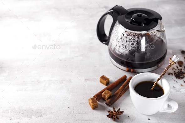 cup of hot coffee with glass teapot for breakfast. - Stock Photo - Images