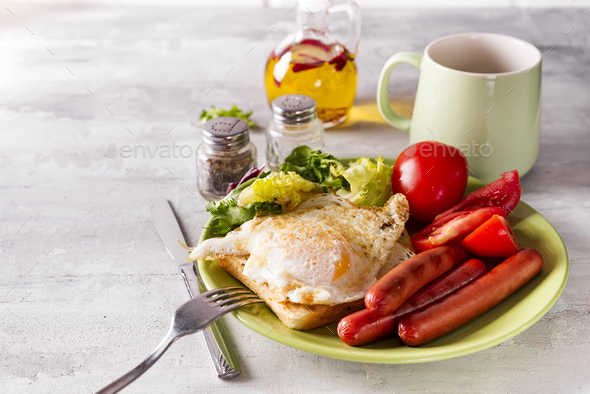 breakfast sandwich with sausage, coffee and tomato - Stock Photo - Images