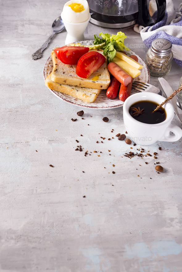 English breakfast. Fried eggs, sausages, toasts, tomatoes on stone table. - Stock Photo - Images