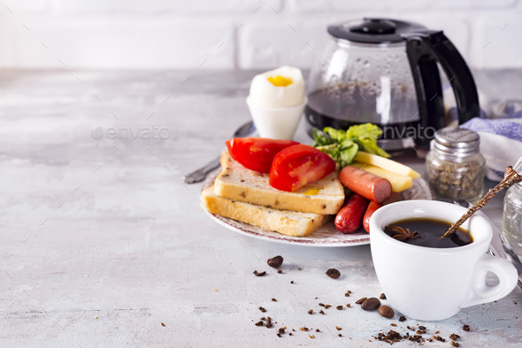Fresh delicious breakfast with soft boiled egg, crispy toasts and cup coffee - Stock Photo - Images