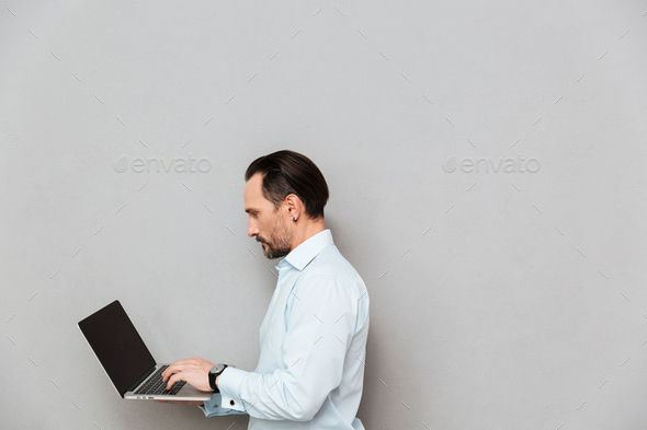 Portrait of a concentrated mature man dressed in shirt - Stock Photo - Images
