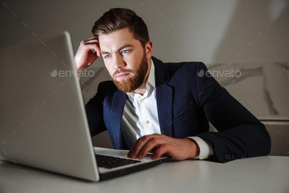 Portrait of a pensive young businessman - Stock Photo - Images