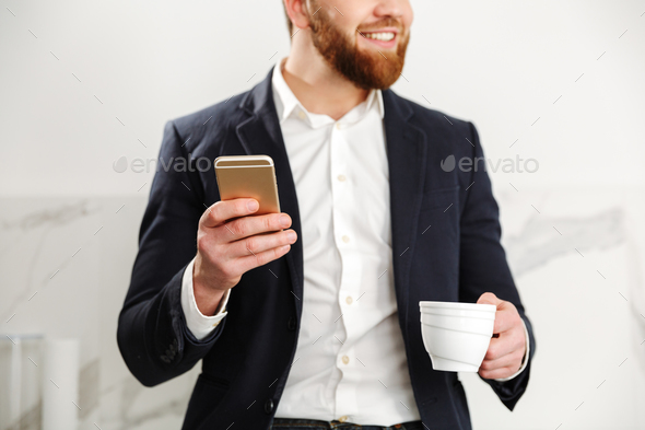 Cropped image of a handsome young businessman - Stock Photo - Images