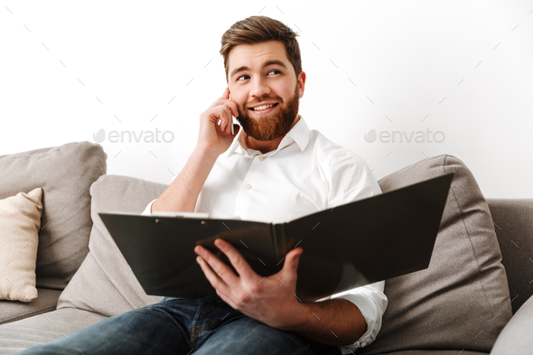 Portrait of a happy young businessman - Stock Photo - Images