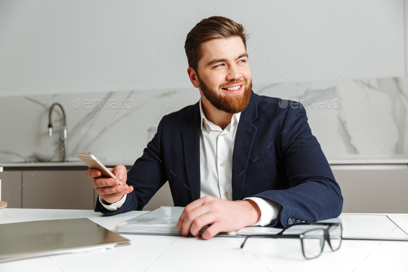 Portrait of a smiling young businessman - Stock Photo - Images