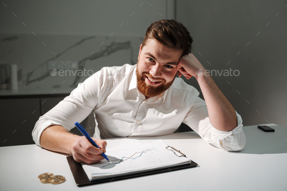Close up portrait of a satisfied young businessman - Stock Photo - Images