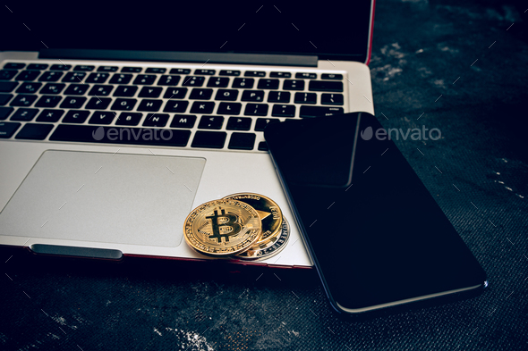 The golden bitcoin on keyboard - Stock Photo - Images